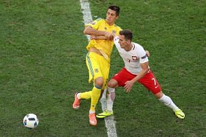 Arkadiusz Milik of Poland (right) and Yevhen Khacheridi of Ukraine in action during the UEFA Euro 2016 group C preliminary round match between Ukraine and Poland at Stade Velodrome in Marseille, France, on June 21, 2016.