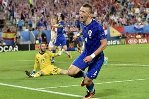 Croatia's midfielder Ivan Perisic celebrates his goal during the Euro 2016 group D football match between Croatia and Spain at the Matmut Atlantique stadium in Bordeaux on June 21, 2016.