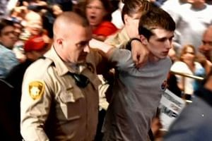 Michael Sandford, 19, was overpowered and escorted out of the Las Vegas rally by police officers last Saturday.