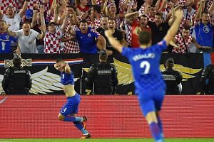 Croatia's midfielder Ivan Perisic (left) celebrates his goal during the Euro 2016 group D football match between Croatia and Spain.