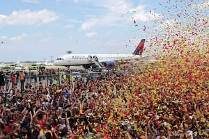 Above: The Cavaliers returning to the Cleveland Hopkins International Airport to a throng of their fans gathering to greet their triumphant team.