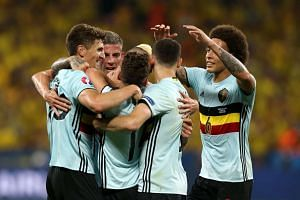 Belgium players celebrate after Radja Nainggolan (not pictured) scored the 1-0 goal.