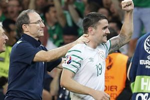 Republic of Ireland head coach Martin O'Neill celebrates with Robbie Brady at the end of the match.