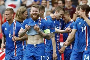Iceland players celebrate the team's first goal.