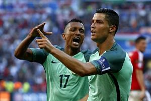 Ronaldo celebrates scoring the 2-2 with Nani.