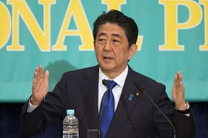 Japan's prime minister Shinzo Abe faces opposition to his move to revise the country's post-war Contitution.