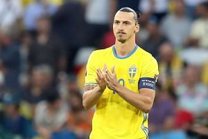 Sweden's forward Zlatan Ibrahimovic claps prior to the start of the match.