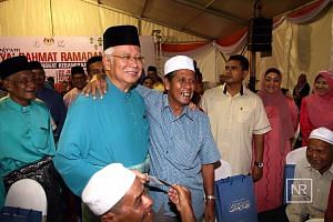 Mr Najib at a Ramadan Blessings event in his Pekan home town in Pahang on Wednesday. The Malaysian Prime Minister seems to have recovered from fending off a corruption scandal tied to state fund 1MDB in the past year. Observers say he may call an ele