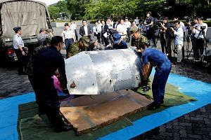 Japan has recovered half of a rocket nose cone (above) suspected to be from a rocket launched by North Korea in February. The 75kg part washed up on a beach in western Japan last Thursday.