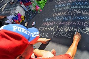 Mr Edwin Rodriguez on Tuesday writing the names of the Orlando shooting victims at the Pulse nightclub. Republican Senator Susan Collins is proposing a compromise gun-control Bill.