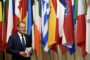 EU Council President Donald Tusk arrives for a statement on Brexit at the EU Headquarters in Brussels on June 24, 2016.