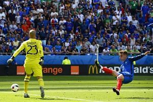 Antoine Griezmann (right) of France in action against Ireland's goalkeeper Darren Randolph (left) during the UEFA Euro 2016 round of 16 match between France and Ireland at Stade de Lyon in Lyon, France, on June 26, 2016.