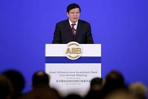 Chinese Finance Minister Lou Jiwei attends the opening ceremony of the first annual meeting of Asian Infrastructure Investment Bank in Beijing, China, on June 25.