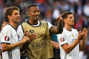 German players Thomas Mueller (left) and Jerome Boateng (centre) celebrate after the UEFA Euro 2016 round of 16 match between Germany and Slovakia at Stade Pierre Mauroy in Lille Metropole, France, on June 26, 2016.