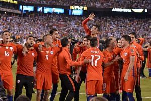Chile's players celebrate after defeating Argentina in the penalty shoot-out and winning the Copa America Centenario final.