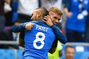 France's Dimitri Payet (left) congratulates Antoine Griezmann after he scored during the Euro 2016 round of 16 football match between France and Republic of Ireland.