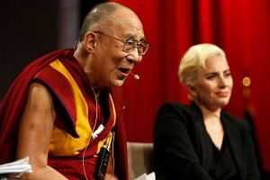 The Dalai Lama and singer Lady Gaga appear together at the US Conference of Mayors 84th Annual Meeting in Indianapolis on June 26, 2016.