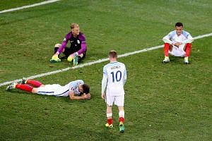 England players react after the 1-2 loss to Iceland at Euro 2016.