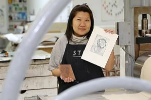 STPI senior printer Chong Li Sze says being a printer, instead of an artist, allows her to make the most of her creative flair and artistic skills.