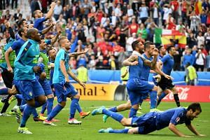 Italy's players celebrate winning the Uefa Euro 2016 round of 16 match between Italy and Spain.