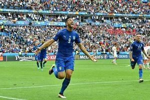 Italy's Pelle celebrates after scoring a goal during the Euro 2016 round of 16 football match between Italy and Spain.