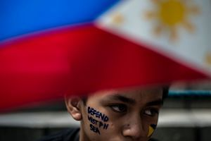 Activists protesting China's activities in the Spratlys, in front of the Chinese Consular Office in Manila on June 10.
