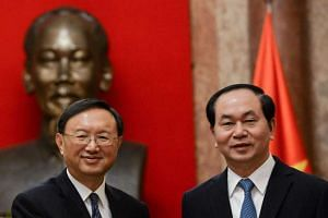 Chinese State Councillor Yang Jiechi (left) with Vietnamese President Tran Dai Quang yesterday. Mr Yang's visit is aimed at strengthening relations at a time when ties are strained amid squabbles over the South China Sea.