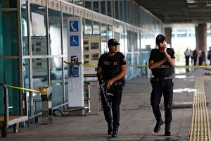 Police officers patrol the Ataturk International Airport, on June 29, 2016.