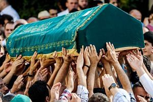 People carry the coffin of suicide attack victim Mohammad Eymen Demirci on June 29, 2016 in Istanbul.
