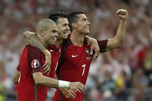 (From left) Portugal's Pepe, Jose Fonte and Cristiano Ronaldo celebrate after winning the penalty shootout