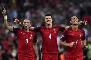 (From left) Portugal defender Pepe, defender Fonte and forward Cristiano Ronaldo celebrate the win.