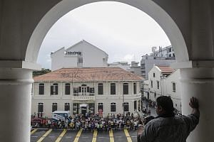 Supporters of Penang Chief Minister Lim Guan Eng gathering outside the court in George Town after his arrest.
