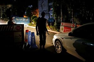 A security personnel checks vehicles after gunmen stormed the Holey Artisan restaurant and took hostages in the Gulshan area of Dhaka, Bangladesh, on July 2.