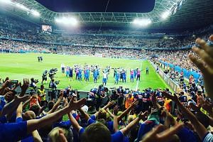 Iceland fans celebrating with their players by doing the war cry, after Monday's 2-1 victory over England in the round of 16.