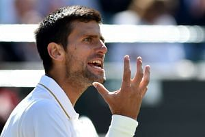 Djokovic reacts while playing US player Sam Querrey.
