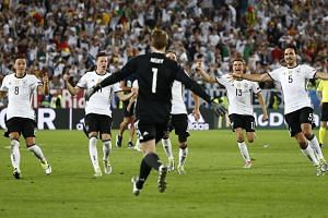 German players celebrate winning the penalty shootout against Italy.