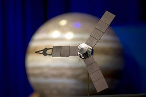 A desktop model of the Juno spacecraft.