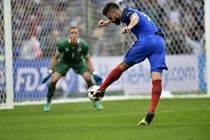 Olivier Giroud (right) of France scores during the Uefa Euro 2016 quarter final match between France and Iceland.