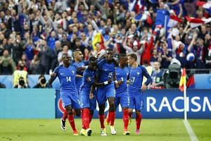 France's Paul Pogba celebrates celebrates scoring their second goal against Iceland.