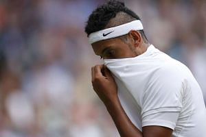 Nick Kyrgios reacts during his match against Andy Murray.