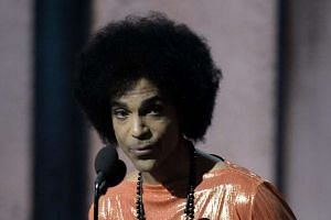 Prince presents an award on stage at the 57th Annual Grammy Awards in Los Angeles.