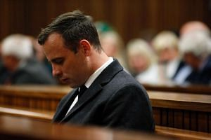 Paralympian athlete Oscar Pistorius looks on during the hearing in his murder trial at the High Court in Pretoria, on July 6, 2016.