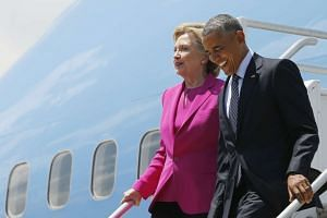 Obama and Clinton arrive to campaign together in North Carolina.