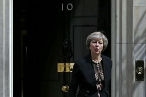 British Home Secretary Theresa May leaves after attending a Cabinet meeting at Number 10 Downing Street in London on July 5, 2016.