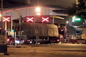 Several China-made MRT trains seen being shipped back to their manufacturer for structural defects.