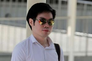 Mark Tan Peng Liat seen leaving the State Courts on Thursday (July 7).