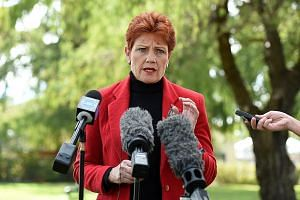 Ms Pauline Hanson speaking during a news conference in Brisbane on Monday. In this election, she has focused her attacks on Muslims, but she has not renounced her claims that Australia needs to limit Asian migration.