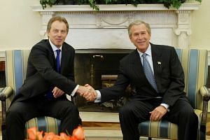 George W. Bush (right) shaking hands with Tony Blair at the White House in April 2004.