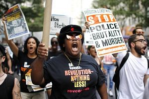 People take part in a protest for the killing of Alton Sterling and Philando Castile in Manhattan, New York, on July 7.