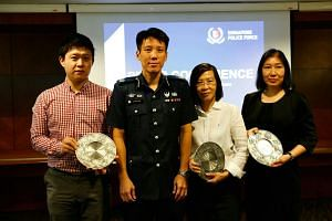 Deputy Assistant Commissioner of Police Arthur Law with Mr Li, Ms Thng and Ms Clara Ling yesterday. Ms Ling collected the Public Spiritedness Award on behalf of Ms Han.